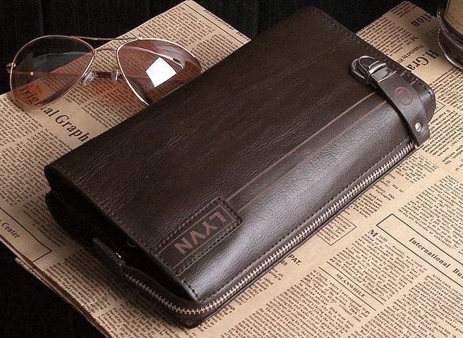 กระเป๋าสตางค์ผู้ชาย หนังแท้ ใบใหญ่ ใส่บัตรได้เยอะ แบบ กระเป๋าถือ มีซิปล๊อค ตรงกลาง แต่งเข็มขัดรัด ด้านหน้า สีน้ำตาลเข้ม กาแฟ no 66593