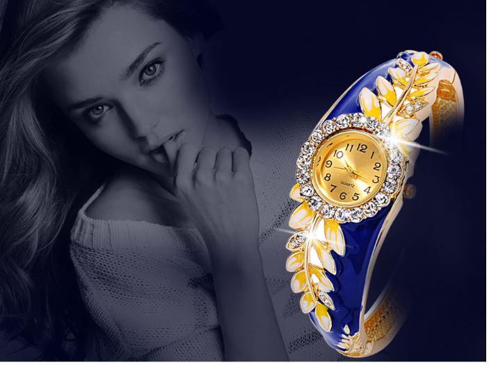 นาฬิกาข้อมือ ผู้หญิง แบบ กำไลข้อมือ หน้าปัดฝังเพชร ออกแบบ เป็น ลายใบไม้ สีทอง ใส่ออกงาน สุดหรู 186747