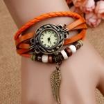 นาฬิกาข้อมือ ผู้หญิง สายหนังถัก สไตล์สร้อยข้อมือ วินเทจ สีส้ม ห้อยจี้ รูปปีกนก หน้าปัดกลม คลาสสิค สวยเก๋ เท่ สุด ๆ 520286