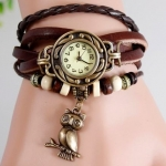 นาฬิกาข้อมือ ผู้หญิง สายหนังถัก สไตล์สร้อยข้อมือ วินเทจ สีน้ำตาล ห้อย นกฮูก